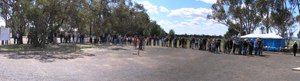 A long queue of people stretches across this panoramic image