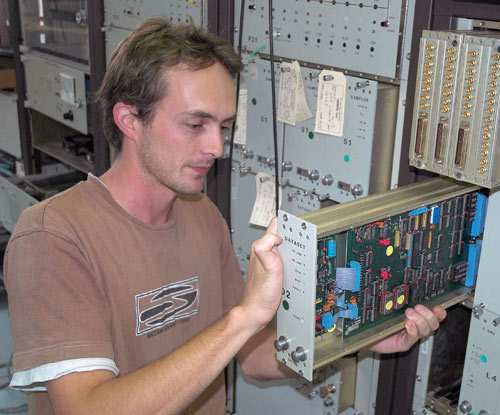 Scott working on electronic components in the back-up test antenna rack.