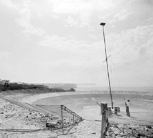 Photo: Gordon Stanley adjusting the antenna mast.