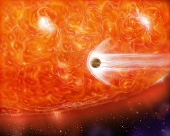 An artist's impression of a red supergiant engulfing a Jupiter-like planet as it expands.