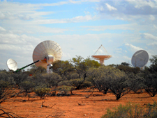 Four of CSIRO's new ASKAP antennas are pictured at the Murchison Radio-astronomy Observatory in Western Australia, October 2010. Credit: Ross Forsyth, CSIRO.