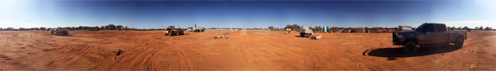 A panorama of an outback site where construction activities are underway. Credit: EMC.