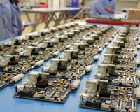 Electronics boards laid out on a factory bench. Credit: CSIRO.