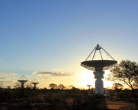 ASKAP antennas in front of a sunset.