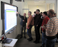 People looking at a SMART board in the Science Operations Centre.