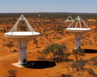 An elevated view of four of CSIRO's new ASKAP antennas at the Murchison Radio-astronomy Observatory (MRO) in Western Australia. The MRO will be the core site of Australia's future SKA activity. Credit: Ant Schinckel, CSIRO.