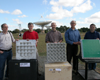 Representatives from NRC, ASTRON and CSIRO with their PAF elements during testing. Credit: John Sarkissian, CSIRO.