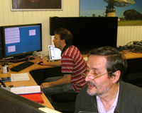 CSIRO astronomers Drs Tasso Tzioumis (foreground) and Chris Phillips during the observing run. Credit: Helen Sim, CSIRO.